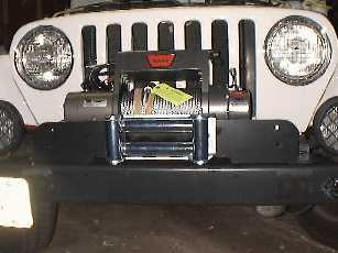 Test fit the plate and winch to the Jeep.